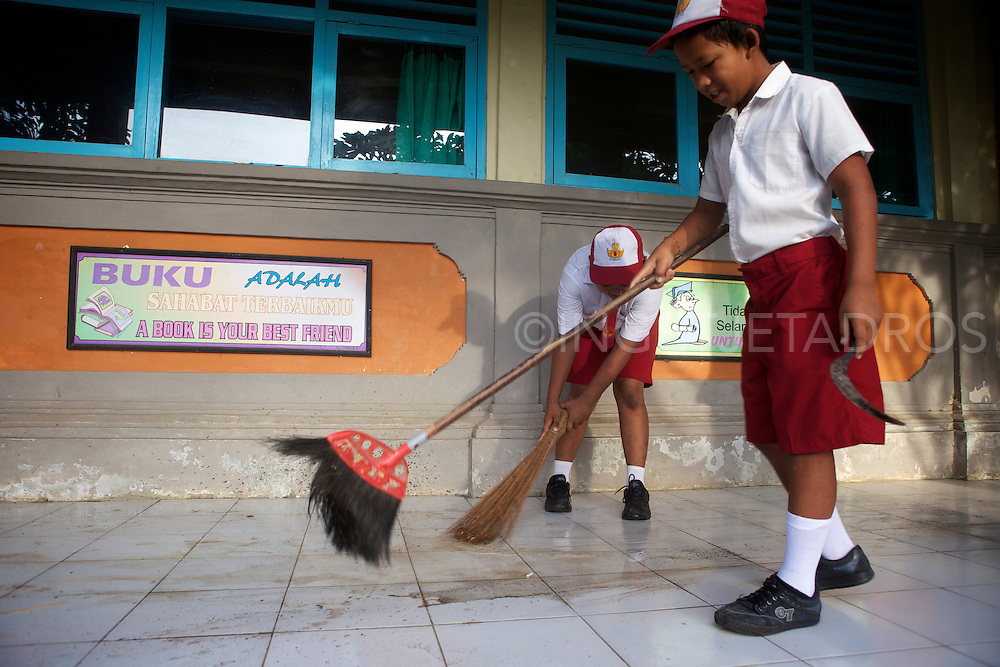 Boys cleaning up after a midterm break.<br /> There was no protest and no swearing, they where all happy to help, a truth delight to watch!<br /> Ubud, Bali 2013