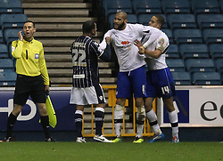 Millwall's DJ Cambell argues with Sheffield Wednesday's Oguchi Onyewu - Photo mandatory by-line: Robin White/JMP - Tel: Mobile: 07966 386802 28/01/2014 - SPORT - FOOTBALL - The Den - Millwall - Millwall v Sheffield Wednesday - Sky Bet Championship
