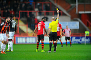 Exeter City's Joel Grant is shown a yellow card during the Sky Bet League 2 match between Exeter City and Luton Town at St James' Park, Exeter, England on 19 December 2015. Photo by Graham Hunt.