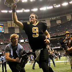 December 4, 2011; New Orleans, LA, USA; New Orleans Saints quarterback Drew Brees (9) celebrates following a win over the Detroit Lions at the Mercedes-Benz Superdome. The Saints defeated the Lions 31-17. Mandatory Credit: Derick E. Hingle-US PRESSWIRE