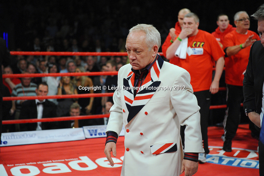 Promoter Frank Maloney, clearly concerned after David Price knocks down Audley Harrison (Harrison gets medical attention in the ring) at the British & Commonwealth Title fight at the Echo Arena, Liverpool on 13th October 2012. Frank Maloney Promotions © Leigh Dawney Photography 2012.