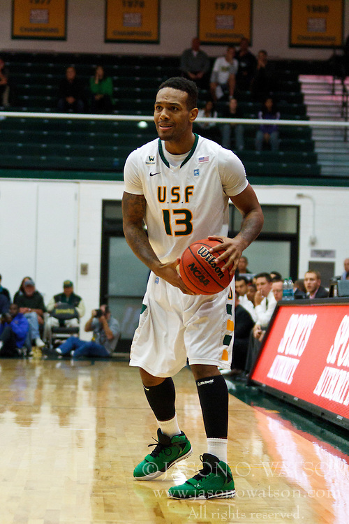 Nov 16, 2011; San Francisco CA, USA;  San Francisco Dons guard Rashad Green (13) holds the ball against the San Jose State Spartans during the first half at War Memorial Gym.  San Francisco defeated San Jose State 83-81 in overtime. Mandatory Credit: Jason O. Watson-US PRESSWIRE