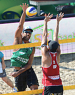 STARE JABLONKI POLAND - July 4: Bruno Oscar Schmidt of Brazil and Adrian Gavira Collado of Spain in action during Day 4 of the FIVB Beach Volleyball World Championships on July 4, 2013 in Stare Jablonki Poland.  (Photo by Piotr Hawalej)