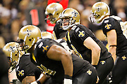 NEW ORLEANS, LA - DECEMBER 26:   Drew Brees #9 of the New Orleans Saints looks over the defense during a game against the Atlanta Falcons at Mercedes-Benz Superdome on December 26, 2011 in New Orleans, Louisiana.  The Saints defeated the Falcons 45-16.  (Photo by Wesley Hitt/Getty Images) *** Local Caption *** Drew Brees