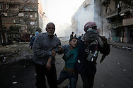 EGYPT, Cairo :  An injured Egyptian protester is helped during clashes with security forces near the Interior Ministry in Cairo, Egypt, Saturday, Feb. 4, 2012..