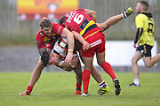 Bradford Bulls second row James Bentley (20) is tackled by Dewsbury Rams stand off Paul Sykes (6) during the Kingstone Press Championship match between Dewsbury Rams and Bradford Bulls at the Tetley's Stadium, Dewsbury, United Kingdom on 10 September 2017. Photo by Simon Davies.