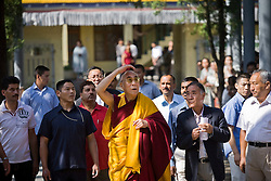 Dalai Lama makes his way toward the temple to attend morning prayer ceremony in Dharamsala, India, May 26, 2009.