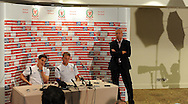 Wales players Joe Allen (l) and Chris Gunter (r) flanked by Welsh team media officer Ian Gwyn Hughes face the cameras. . Wales football players media session at St.Davids Hotel in Cardiff on Tuesday 4th Sept 2012, the Welsh players talk about their forthcoming World cup qualifier against Belgium on Friday 8th Sept.  pic by  Andrew Orchard, Andrew Orchard sports photography,