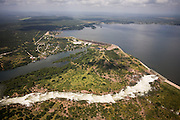 After torrential rainstorms, Wirtz Dam lets water out of Lake Lyndon B. Johnson through its spillway, to prevent flooding on the reservoir's shores.  Controlled water release from reservoirs is usually dictated by periods of peak energy use and water demands for irrigation and recreational use.