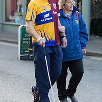 Bishop of Killaloe Fintan Monahan helped by Eithne Killeen of Seeking vision Clare in Walk a mile for the blind in Ennis