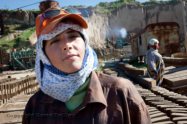 Tajikistan: Women predominantly staff factories, such as this brick-making outfit. Up to half of Tajikistan's male workforce is in Russia. May 2009.