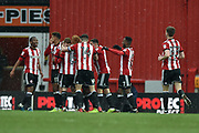 Brentford Players Celebrate after Brentford Midfielder, Lewis Macleod (4) scores a goal to make it 1-1 during the EFL Sky Bet Championship match between Brentford and Middlesbrough at Griffin Park, London, England on 17 March 2018. Picture by Adam Rivers.