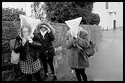 Teenage girls in the rain. Eastbourne. 27 January 2016