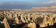 Fairy chimneys in the eroded landscape of Goreme National Park, between Goreme and Uchisar, in Nevsehir province, Cappadocia, Central Anatolia, Turkey. The rock formations here were made by erosion of the volcanic tuff created by ash from volcanic eruptions millions of years ago. The Goreme Valley also contains cave dwellings, underground towns and churches, carved out of the rock in the Byzantine period. This area forms part of the Goreme National Park and the Rock Sites of Cappadocia UNESCO World Heritage Site. Picture by Manuel Cohen
