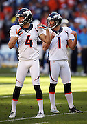 Denver Broncos punter Britton Colquitt (4) and Denver Broncos kicker Connor Barth (1) mimic their hand, leg, and body positions as they look toward the bench area during the NFL week 15 regular season football game against the San Diego Chargers on Sunday, Dec. 14, 2014 in San Diego. The Broncos won the game 22-10. ©Paul Anthony Spinelli