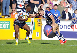 Bristol Rugby's Andy Short tackles Bedford Blues' Sam Stanley  - Photo mandatory by-line: Joe Meredith/JMP - Tel: Mobile: 07966 386802 06/10/2013 - SPORT - FOOTBALL - RUGBY UNION - Memorial Stadium - Bristol - Bristol Rugby V Bedford Blues - The Championship