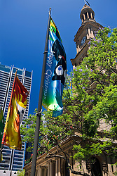 "Banners saying ""Happy Christmas"" fly in front of Town Hall, Sydney, New South Wales, Australia"