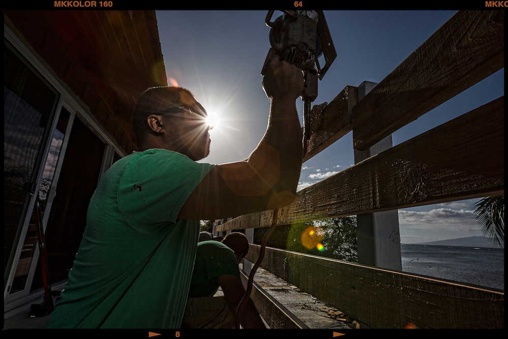 "Tim Emmanuel, 32, Construction Worker shown working on  remodeling project at Hotel Molokai.  ""I enjoy solving new obstacles and challenges everyday - keeps things interesting."""