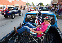 Ben Hollingsworth watches the Lone Tree Days Parade from the bed of his pickup truck in downtown Central City.