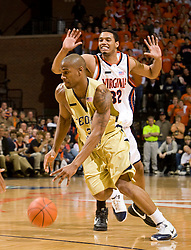 Georgia Tech forward Jeremis Smith (32) dribbles past Virginia forward Mike Scott (32).  The Virginia Cavaliers men's basketball team fell to the Georgia Tech Yellow Jackets 92-82 in overtime at the John Paul Jones Arena in Charlottesville, VA on January 27, 2008.