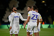 Leeds United forward Tyler Roberts (11) and Leeds United midfielder Mateusz Klich (43) celebrate at full time during the EFL Sky Bet Championship match between Hull City and Leeds United at the KCOM Stadium, Kingston upon Hull, England on 2 October 2018.