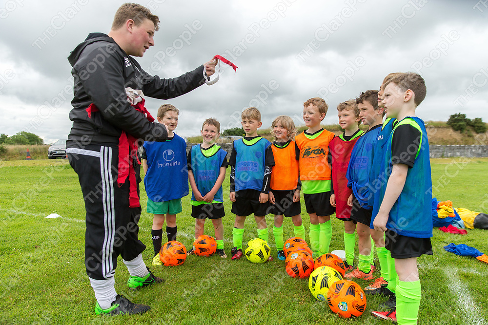 Coach Mathew Crowe from Lahinch having a team talk to the U9's group at the FAI Soccer Summer camp in Kilmaley