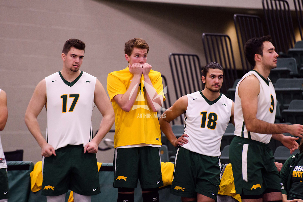 1st year middle blocker Mason Issel (14) of the Regina Cougars in action during the Women's Volleyball Home Game vs U of C Dinos on October21 at the CKHS University of Regina. Credit Arthur Ward/©Arthur Images 2017
