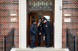 © London News Pictures. 02/05/2015. Police and hospital security stand in the doorway of the hospital before Catherine Duchess of Cambridge and Prince William leave the Lindo Wing of St Mary's hospital in London holding their new born baby daughter, Princess of Cambridge. Photo credit: Ben Cawthra /LNP
