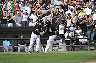 CHICAGO - AUGUST 14:  Juan Uribe #5 of the Chicago White Sox is congratulated by third base coach Jeff Cox #6 after hitting the fourth of four consecutive White Sox home runs, tying a Major League record, during the game against the Kansas City Royals at U.S. Cellular Field in Chicago, Illinois on August 14, 2008.  The White Sox defeated the Royals 9-2.  (Photo by Ron Vesely)