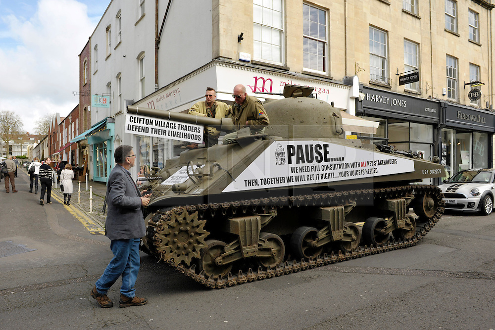 &copy; Licensed to London News Pictures. 09/04/2014; Bristol, UK.  Tony Miles, aka Smiley Miley from the Radio 1 Roadshow, organised a WW2 Sherman tank to drive through local streets in a protest by residents and traders from Clifton Village in Bristol about plans for a Residents Parking Scheme in their area from Bristol's elected Mayor, George Ferguson.  They say the business and social life of the area will be hit very hard by the RPS with customers and visitors unable to park, and that some businesses will have to close or move away from the area.  The tank is a symbol of defending their area against RPS.<br /> Photo credit: Simon Chapman/LNP