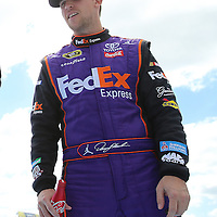 Race car driver Denny Hamlin is seen during driver introductions prior to the 58th Annual NASCAR Daytona 500 auto race at Daytona International Speedway on Sunday, February 21, 2016 in Daytona Beach, Florida.  (Alex Menendez via AP)