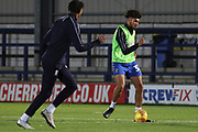 AFC Wimbledon midfielder Tyler Burey (32) and AFC Wimbledon defender Toby Sibbick (20) warming up during the EFL Trophy group stage match between AFC Wimbledon and Stevenage at the Cherry Red Records Stadium, Kingston, England on 6 November 2018.