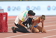 Maureen Koster (NED) is assisted by medical personnel after falling in a women's 5,000m heat during the IAAF World Athletics Championships, Wednesday, Oct 2, 2019, in Doha, Qatar. (Claus Andersen/Image of Sport)