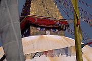 Prayer Flags Surround Tibetan Buddha Temple Face