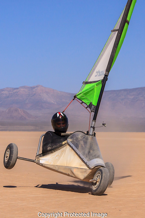 Former blowkart land speed record holder,Scott Young speeds across Red Lake, Arizona.