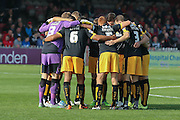 Cambridge United huddle up during the Sky Bet League 2 match between York City and Cambridge United at Bootham Crescent, York, England on 3 October 2015. Photo by Simon Davies.