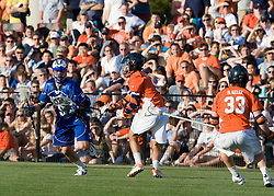 Duke midfielder Michael Ward (9) is defended by Virginia attackman Danny Glading (9).  The #3 ranked Virginia Cavaliers fell to the #2 ranked Duke Blue Devils 19-9 at the University of Virginia's Klockner Stadium in Charlottesville, VA on April 12, 2008.