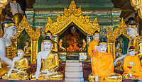 Buddha statues of the Shwedagon Pagoda at Yangon (Rangoon) in Myanmar (Burma)