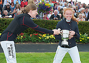 28/07/2014  Nenagh Carberry and Jane Mannion joke about who should keep trophy . The Galway Summer Racing Festival at Ballybrit in Galway City continues till Sunday. Photo:Andrew Downes