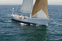 Crew sitting on side of sailboat elevated view