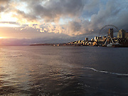 Seattle, Washington at sunset. Puget Sound and and the incoming storm glow as the sunsets. Taken from the Washington State Ferry with an iPhone