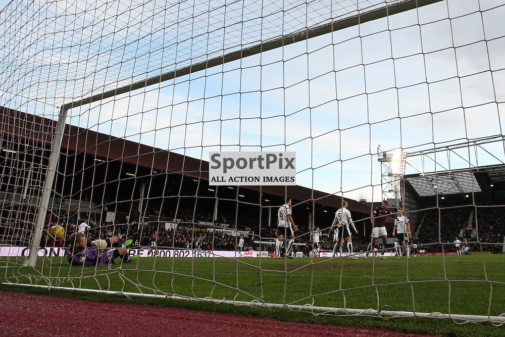 Arnauld Sutchuin of Hearts (out of picture) opens the scoring during the Ladbrokes Scottish Premiership match between Heart of Midlothian FC and Dundee FC at Tynecastle Stadium on November 21, 2015 in Edinburgh, Scotland. Photo by Jonathan Faulds/SportPix