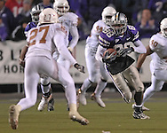 Kansas State wide receiver Cedric Wilson (88)takes off up field after making a catch, Texas safety Michael Griffin (27) moves in at Bill Snyder Family Stadium in Manhattan, Kansas, November 11, 2006.  The Wildcats upset the 4th ranked Longhorns 45-42.<br />