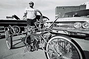 A man posing behind a customised Lo-Rider tricycle bike, Viva Las Vegas Festival, Las Vegas, USA 2006.
