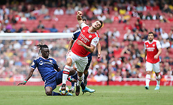 Granit Xhaka of Arsenal is fouled by Bertrand Traore of Lyon - Mandatory by-line: Arron Gent/JMP - 28/07/2019 - FOOTBALL - Emirates Stadium - London, England - Arsenal v Olympique Lyonnais - Emirates Cup