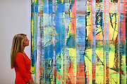 "© Licensed to London News Pictures. 31/01/2013. London, UK A woman stands in front of Gerhard Richter's .""Abstraktes Bild"" Expected to raise 2,200,000 -.2,800,000 GBP. Preview of highlights from Sotheby's forthcoming February sales of Impressionist & Modern Art and Contemporary Art in London, including works by Picasso, Bacon, Monet, Richter and Miró. Photo credit : Stephen Simpson/LNP"