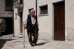 Sasso di Castalda (PZ), 19.07.2009, Italy - Sasso di Castalda è un paesino della provincia di Potenza che conta circa mille abitanti. E' paese natale dei genitori di Rocco Petrone, direttore del lancio Nasa che portò il primo uomo sulla luna nel 1969. Nella Foto: Rocco Petrone, 86 anni, cugino del più famoso Rocco Petrone, direttore del lancio Nasa che portò il primo uomo sulla luna nel 1969 davanti la casa che fu del nonno Giovanni Petrone..Photo by © Giovanni Marino/OTNPhotos - obligatory credit -