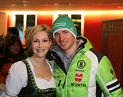 27.01.2014, JUFA, Schladming, AUT, FIS Weltcup Ski Alpin, Slalom, Herren, Startnummernauslosung, im Bild Felix Neureuther (GER) mit einer Dame in Tracht //  Felix Neureuther of Germany with a girl during the public draw for Schladming FIS Ski Alpine World Cup 2014 at the Planai course in Schladming, Austria on 2014/01/27. EXPA Pictures © 2014, PhotoCredit: EXPA/ Martin Huber