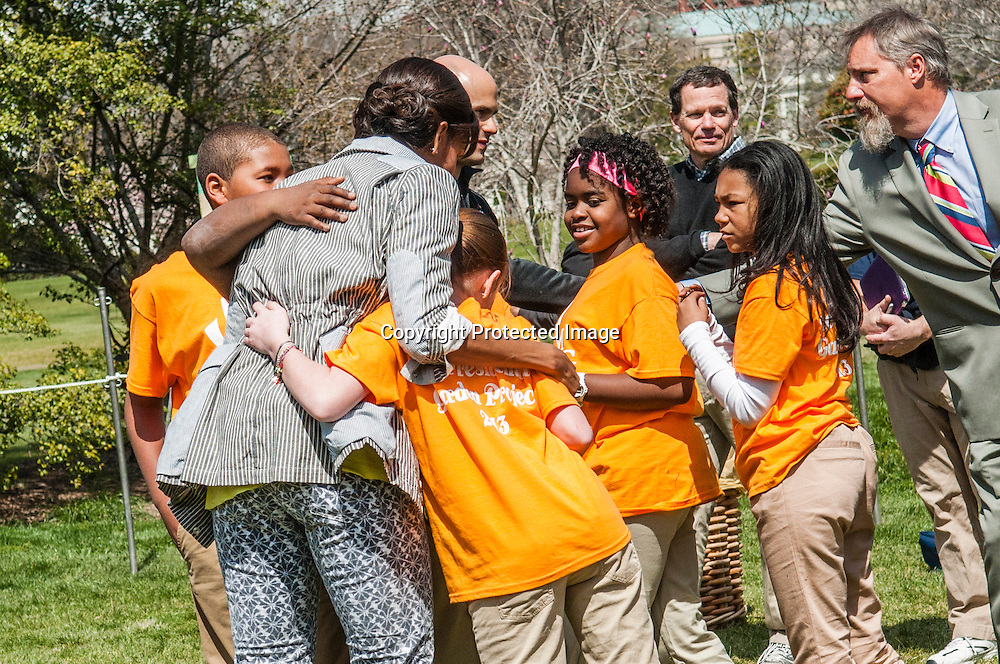 (L-R) Jalen Hurston, Jordan Wilson, Eliza Croom, Kyla Bourne, and Rachel Bradley of Sarah Moore Greene Magnet Technology Academy School, Knox County, TN hug First Lady Michelle Obama during an event where they planted the White House Kitchen Garden for the fifth year in a row at the White House on April 4, 2013 in Washington DC. Photo by Kris Connor