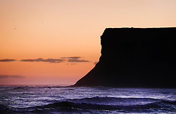 © Licensed to London News Pictures. <br /> 03/10/2016. <br /> Saltburn-by-the-Sea, UK.  <br /> <br /> The first light of dawn rises behind Huntcliff on a cold October morning at Saltburn-by-the-Sea.<br /> <br /> Photo credit: Ian Forsyth/LNP